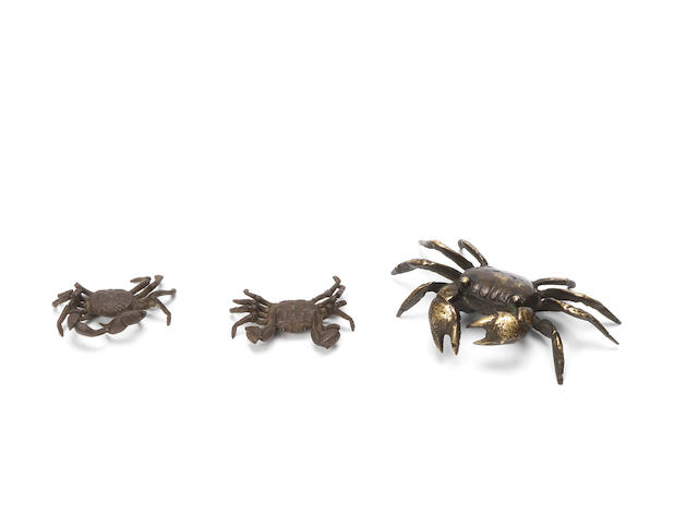 A small pair of articulated iron crabs and a gilt-bronze crab Meiji Period