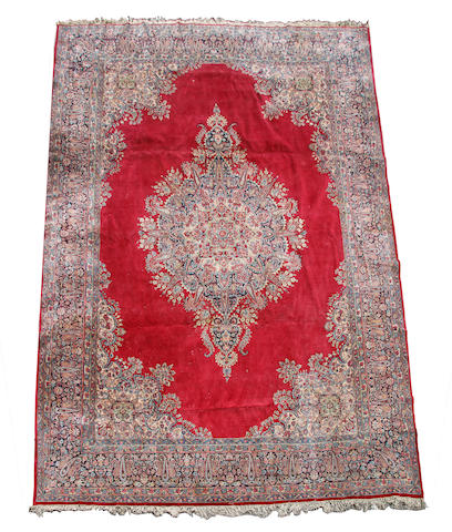 A large Kirman carpet South East Persia, 420 x 340cm