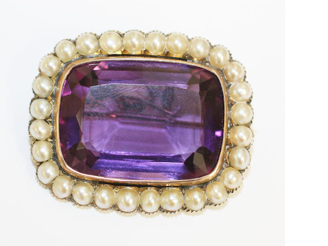 An amethyst and pearl brooch