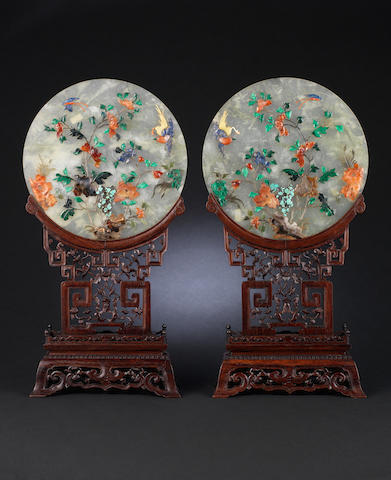 A pair of relief-moulded hardstone table screens on hardwood stands