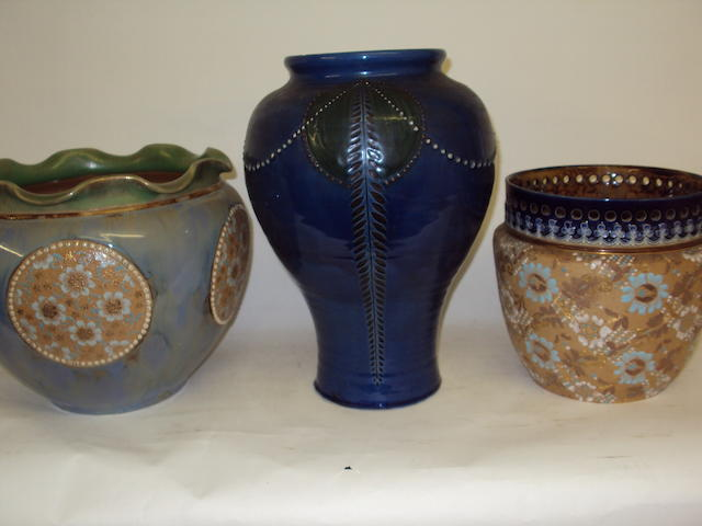 A Royal Doulton jardiniere, a Doulton Lambeth Slaters Patent jardiniere, and a C.H. Brannam vase