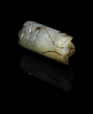 A small, green/grey jade cicada pendant