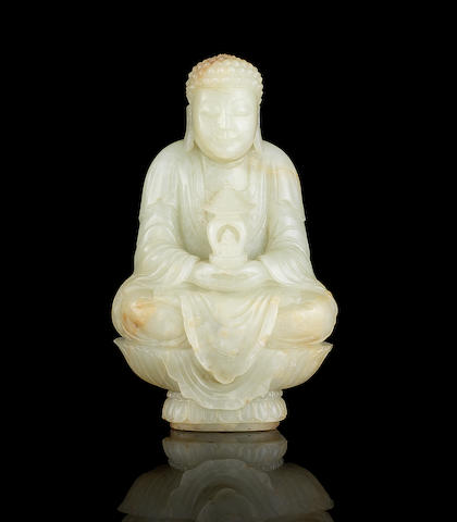 A fine rare pale green jade carving of Buddha 18th century