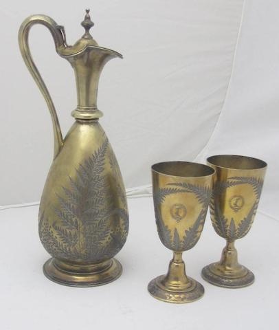 A Victorian silver gilt presentation claret jug and matching pair of cups by Stephen Smith, London 1869/70  (3)