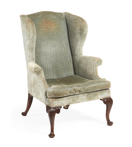 An early 20th century mahogany wingback armchair in the George II style