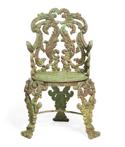 A late 19th century green painted cast iron chair
