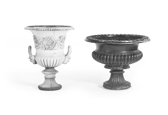 Two Victorian cast iron garden urns