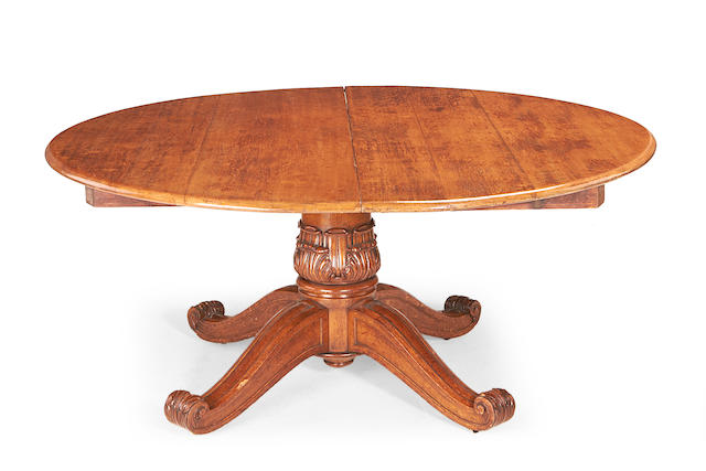 An unusual late Regency oak extending dining table