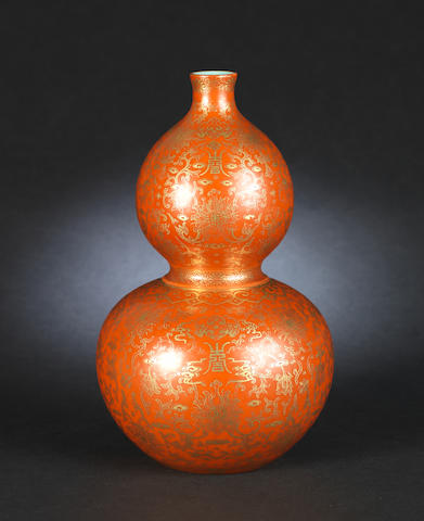 A red ground double gourd vase decorated with gilt, Qianlong mark, box