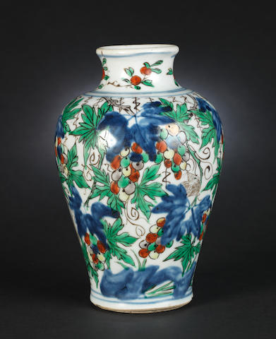 A small wucai, baluster vase decorated with squirrels and vine