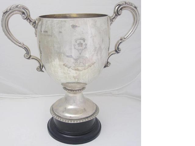 A twin handled silver presentation cup by Goldsmiths and Silversmiths Co. Ltd., London 1900