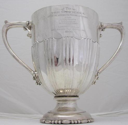 A twin handled presentation cup by Goldsmiths and Silversmiths Co. Ltd., London 1903