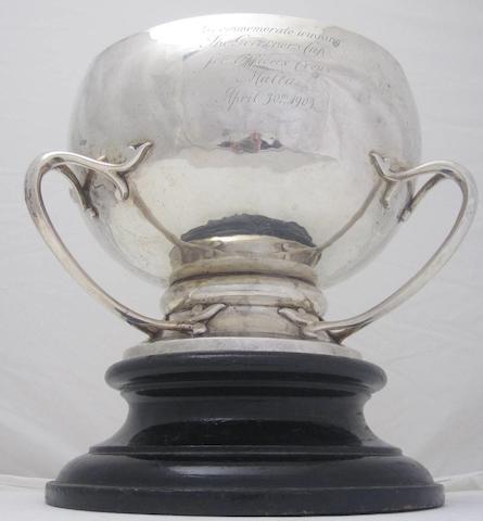 A three handled silver presentation bowl by Goldsmiths and Silversmiths Co. Ltd.,  London 1902