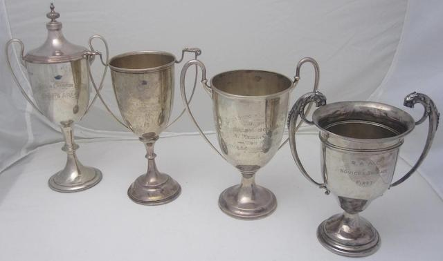 A collection of four silver presentation cups various makers and dates  (4)