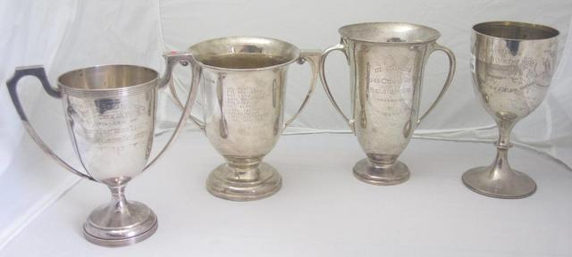 Four silver presentation cups various makers and dates