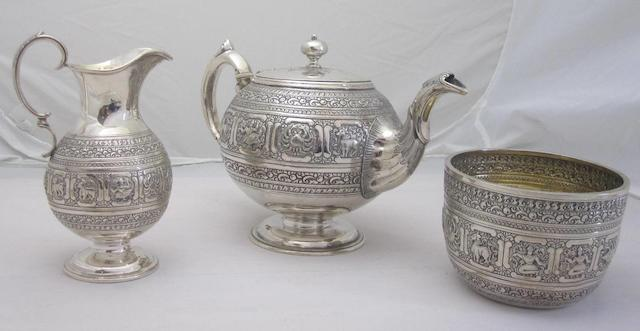 A Victorian three piece silver zodiac tea service by D.C.Rait of Glasgow, Edinburgh 1865  (3)