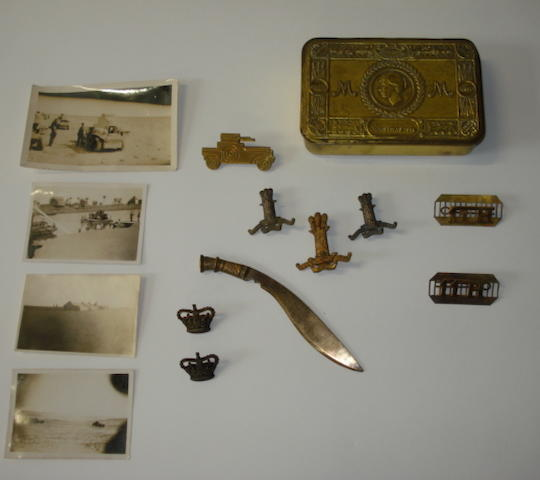 A rare collection of World War One 11TH Hassars badges,