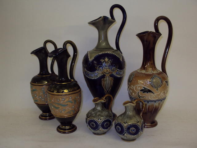 A small collection of Royal Doulton ewers
