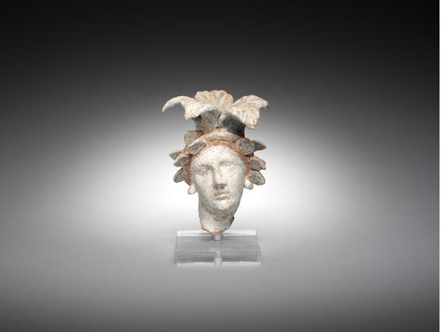 Canosan polychrome head of a lady, 5 ¾ in (14.5cm),
