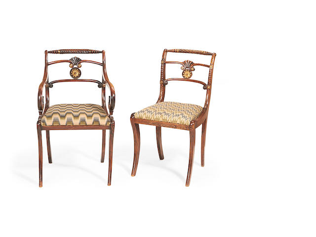 A set of seven Regency simulated calamander dining chairs