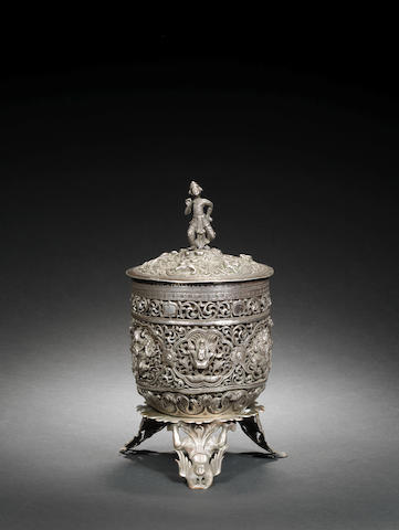 A silver lidded box with stand Tibet or Burma, late 18th Century