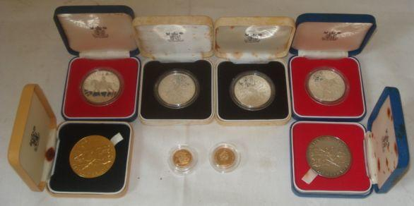 1980 proof gold sovereign cased, 1980 proof gold half sovereign, cased, 1997, a cased Elizabeth II Jubilee silver medallion, another gilt medallion, two 1977 sterling proof Crowns, two Queen Mother 80th Birthday proof silver Crowns. (8)