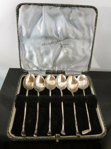 A boxed set of silver golfing spoons