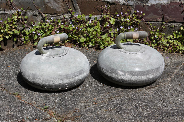 A pair of polished granite curling stones