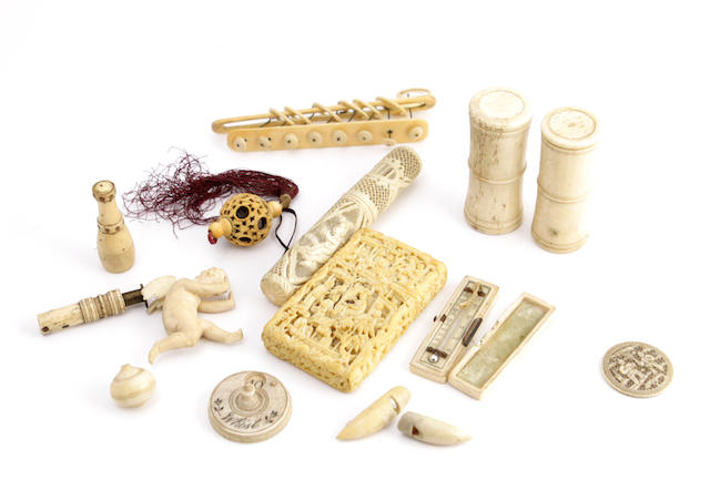 A small quantity of carved turned ivory objects