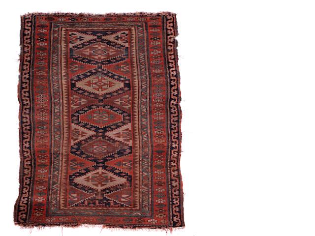 An East Caucasian rug 234cm x 114cm.