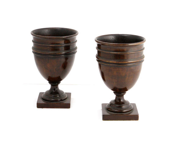 A pair of George III style stained boxwood treen goblets