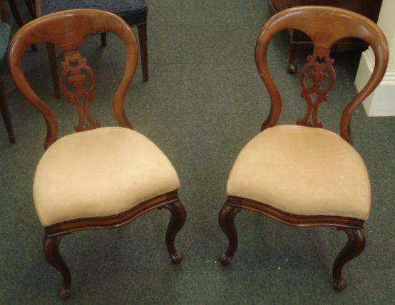 A set of four Victorian mahogany balloon back dining chairs, stamped 'JRs Patent', with pierced splats, upholstered seats, on cabriole legs.