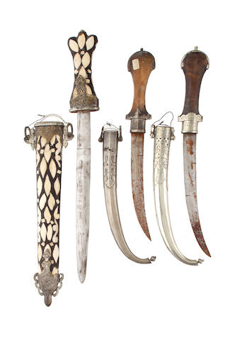 Two Mid esatern daggers in silver sheaths and inlaid wooden short sword