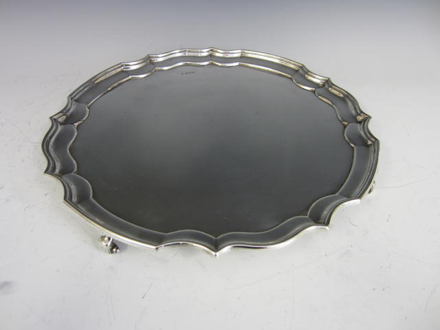 A silver circular salver by Dixon Brothers, Sheffiled 1918