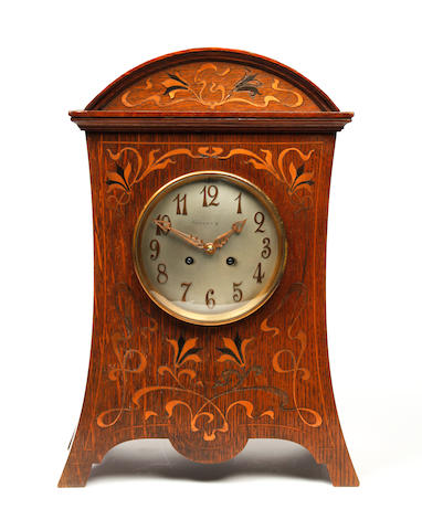 An Art Nouveau oak and inlaid brass mantle clock Tiffany & Co
