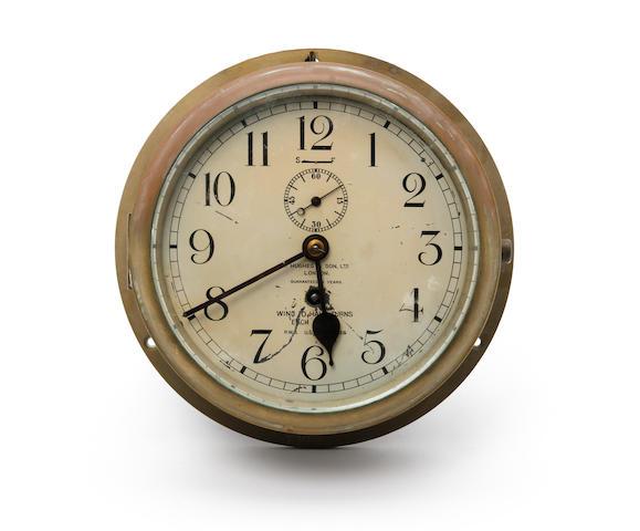 An early 20th century brass bulkhead timepiece,  H Hughes & Son