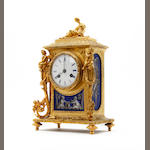 A mid 19th Century ormolu and porcelain mantel clock,  Howell & James, Paris