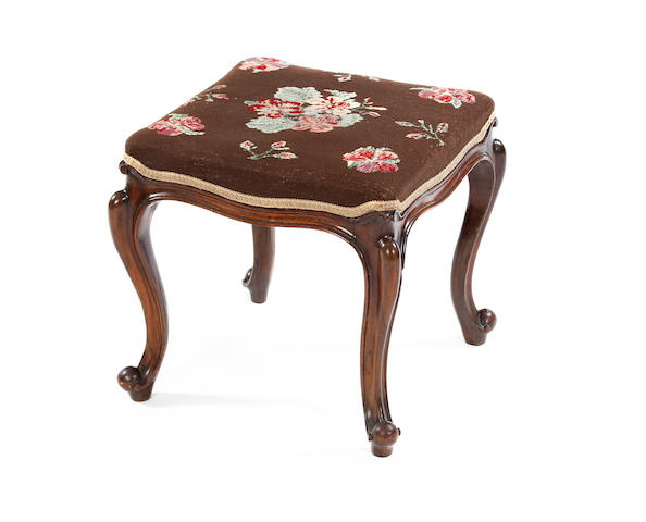 A mahogany-framed dressing stool