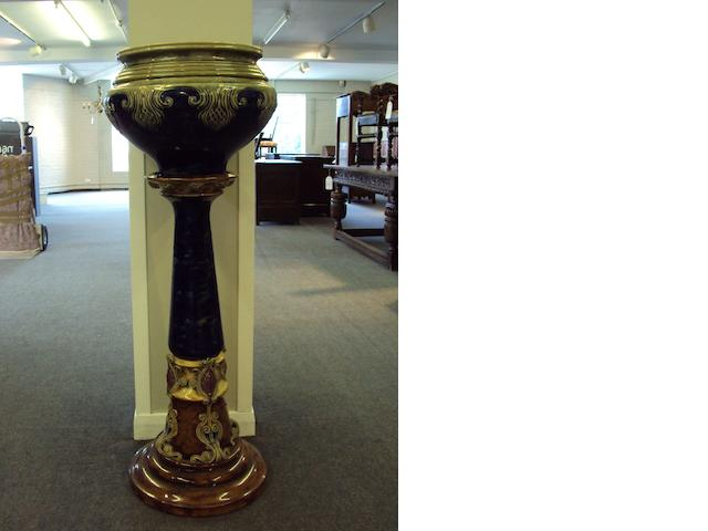 A large Doulton Lambeth jardiniere and stand