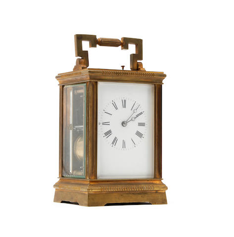 A 19th century french brass repeating carriage clock Francois-Arsene' Margaine