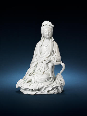 A fine blanc-de-chine seated figure of Guanyin 18th century
