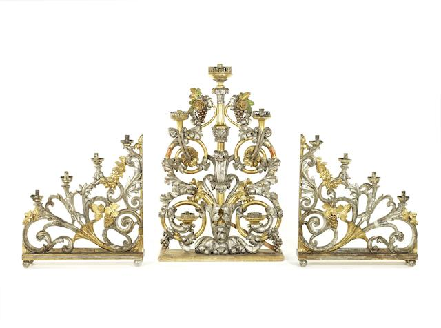 A set of three large Italian Barocco polychrome decorated, silvered and gilt wood candelabra en girandoles