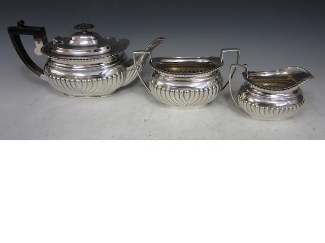 A Victorian silver composite three piece tea service Sheffield 1898, London 1900  (3)