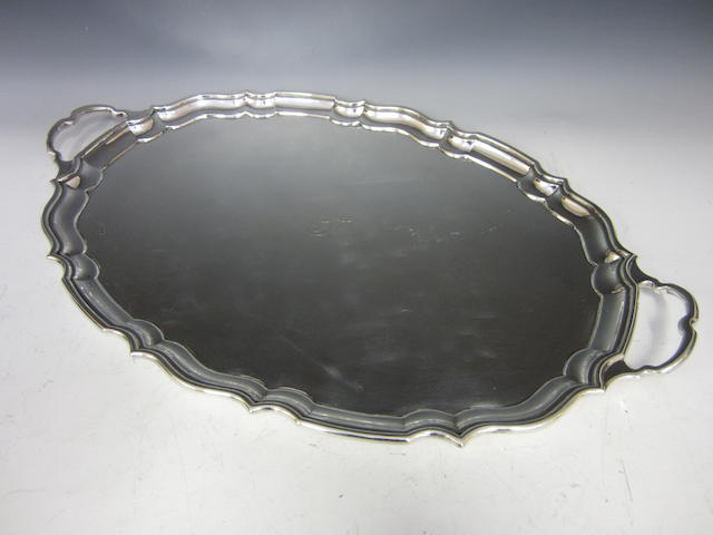 A silver oval two handled tray Sheffield 1918, marks rubbed,