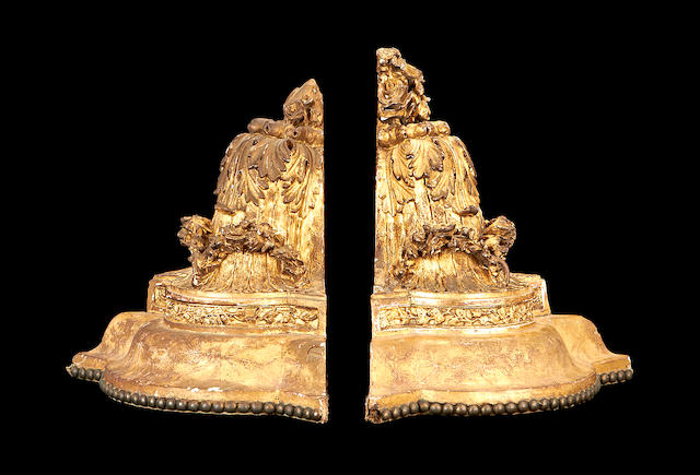 A pair of 19th century giltwood corner wall brackets