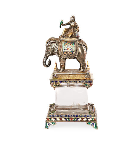 An enamelled silver-gilt Elephant and rider on a rock crystal base France or Austria, late 19th Century