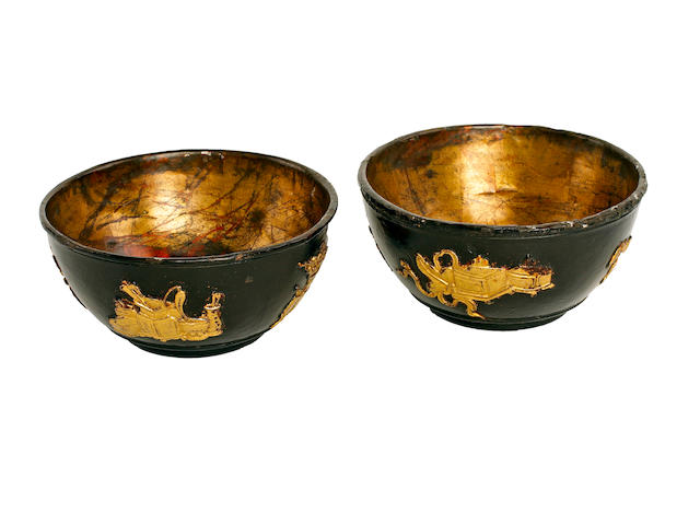 A pair of coconut cups with applied decoration, 17th century