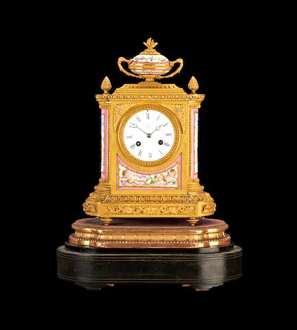 A late 19th century French ormolu and porcelain mounted mantel clockretailed by Goldsmiths' Alliance
