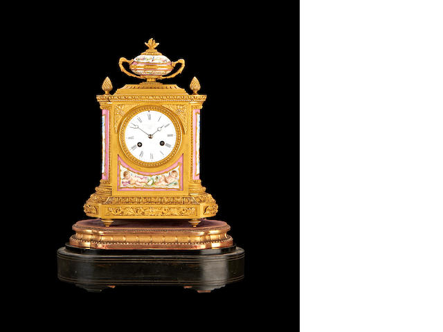A French porcelain-mounted ormolu clock with glass dome, retailed by Goldsmith's Alliance