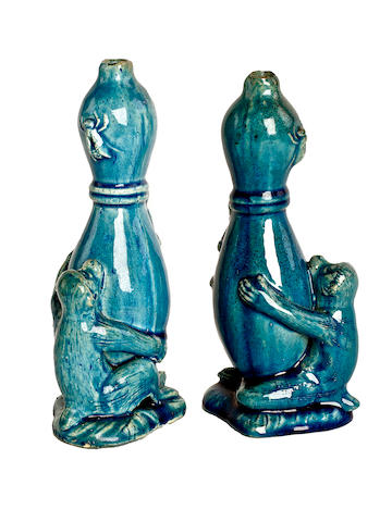 A pair of turquoise monochrome vases,
